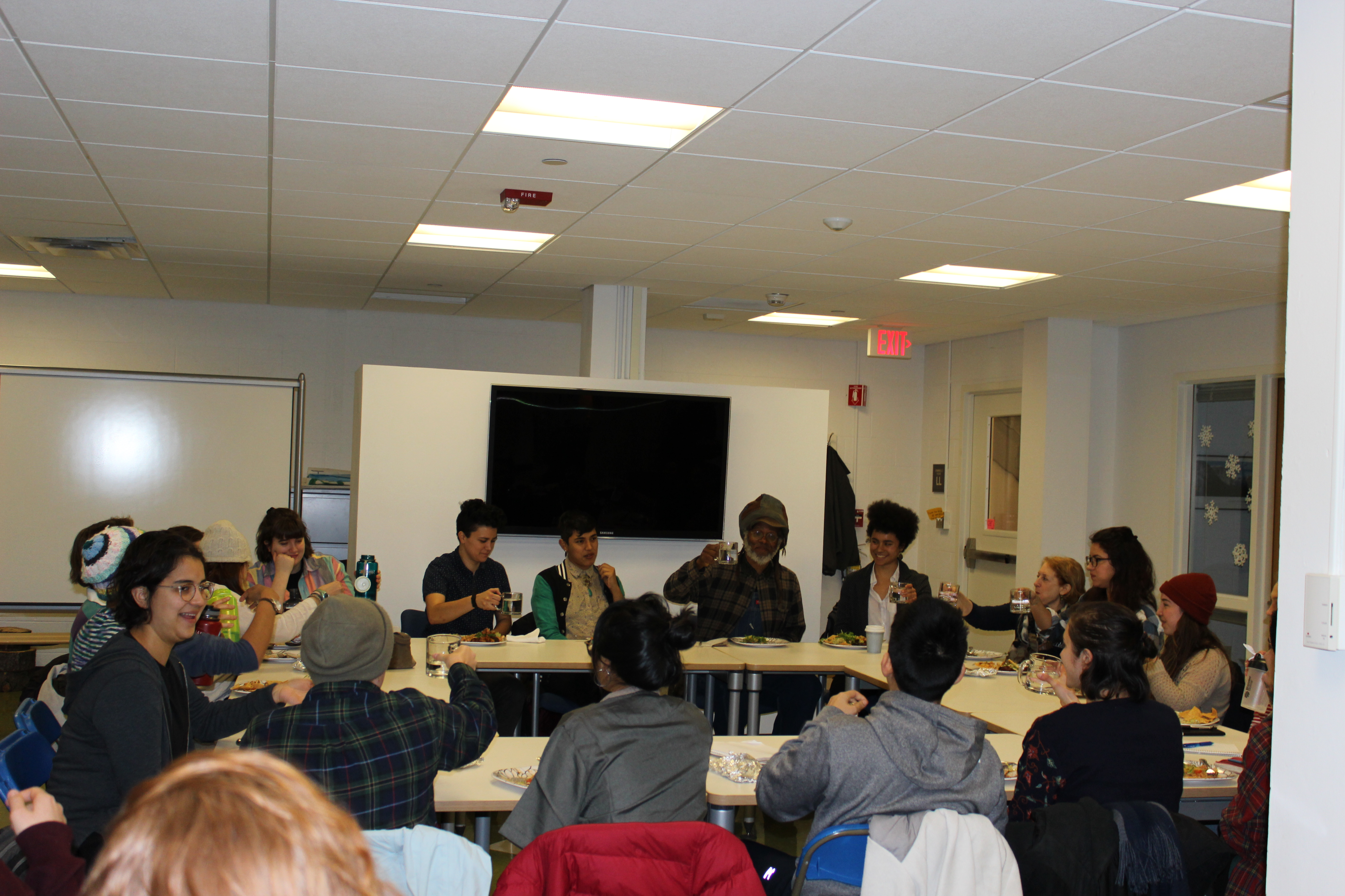 Picture of the event with Maurice Small and students around a table