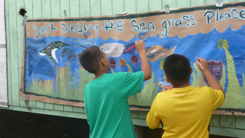 Coral Reef campers working on an educational banner