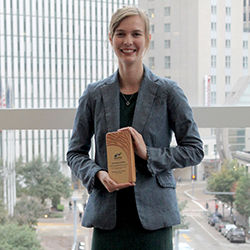 Breanna Parker holding campus sustainability research award