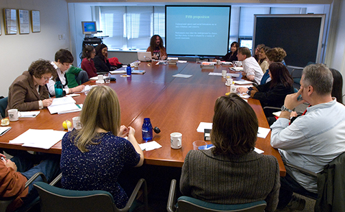 Kahn Institute fellows meeting in a conference room