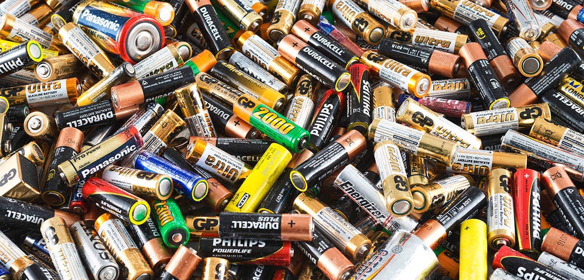 A large pile of discarded batteries