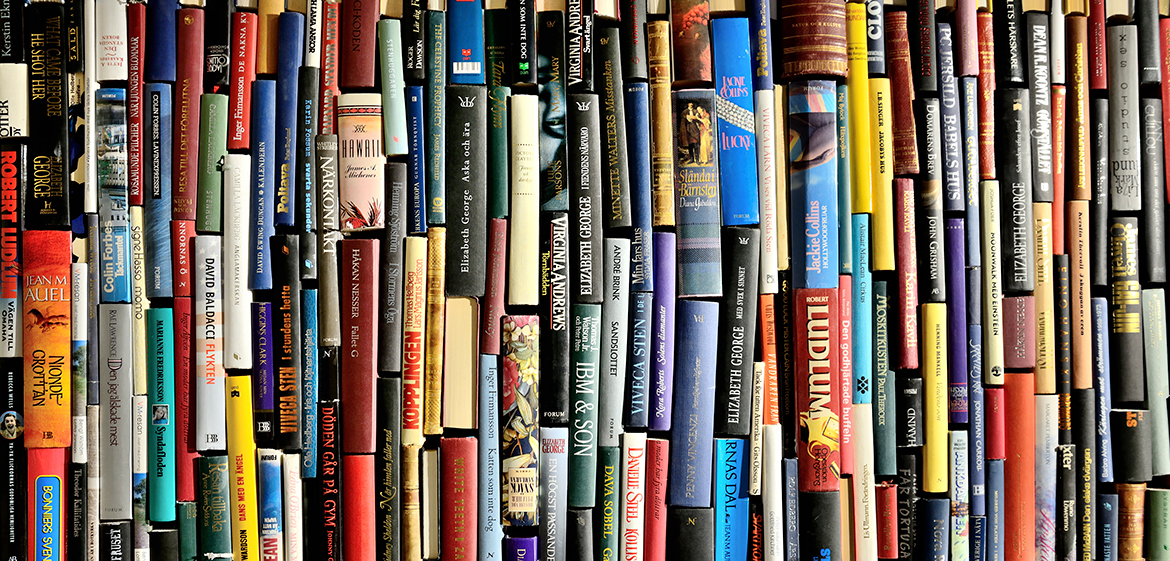 Closeup of the spines of a large collection of books