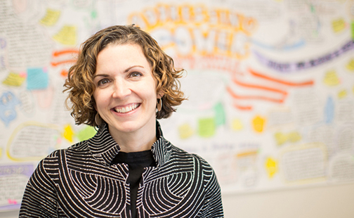Erin Park Cohn '00 against an out-of-focus white board covered with writing in bright marker