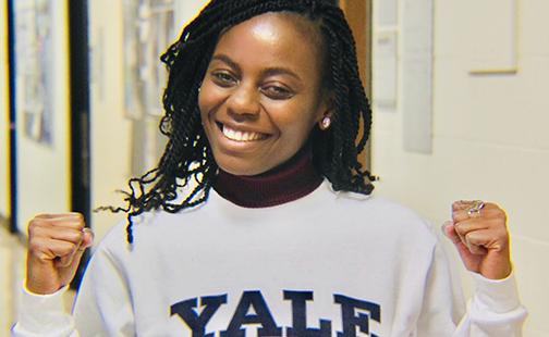 Headshot of Ketty Munyenyembe '20 wearing a Yale sweatshirt