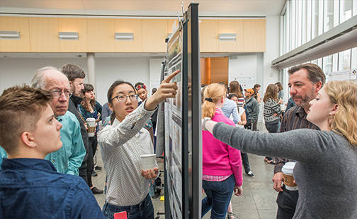 Two students present posters at Celebrating Collaborations