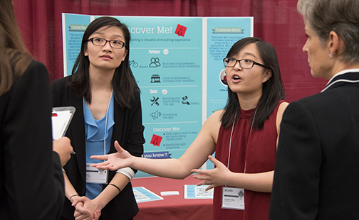Two students presenting at the Draper Competition