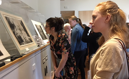 Two students looking at three rare Rembrandt prints during a study session at the Smith College Museum of Art.