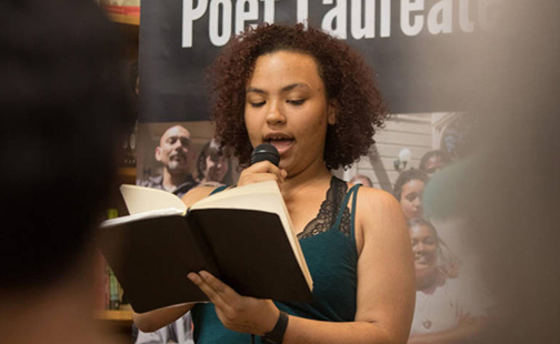 Leila Mottley reading from a book of poetry