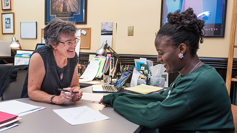 Dean Stangl meeting with student
