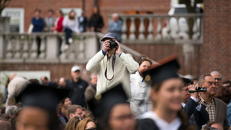 Photographer in the crowd at Commencement
