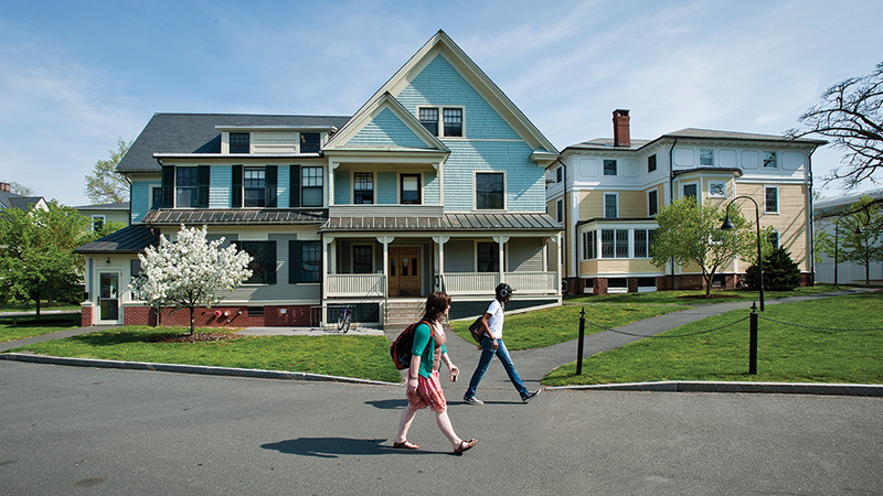 Students walking past a residential house