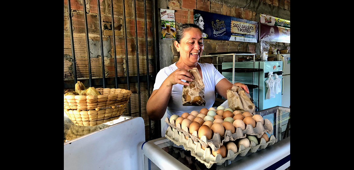 Photo of a baker working at a stall selling eggs