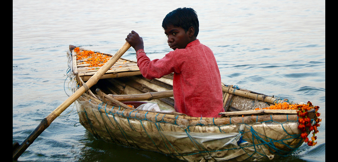 Photo of a boy in a boat in India