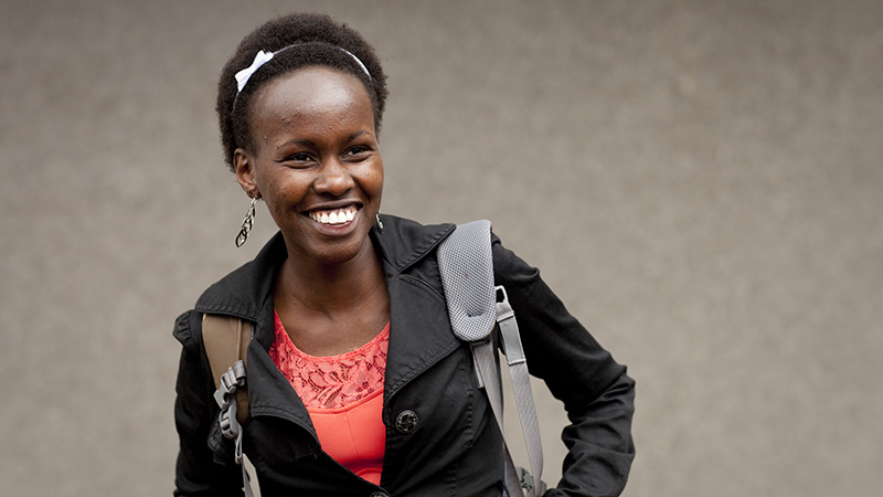 Cynthia Masai, from Kenya, smiles off-camera