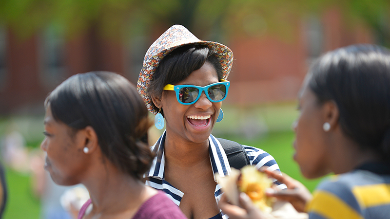Student in a summer hat and sunglasses