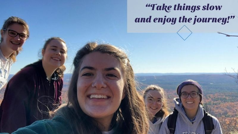 """Five smiling white people on top of a mountain. Overlay text, """"Take things slow and enjoy the journey!"""""""