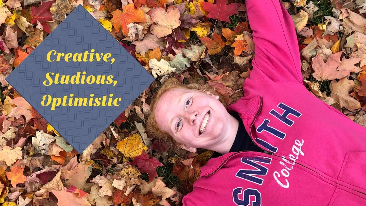 """Maddie Wettach laying in autumn leaves. Overlay: """"Creative, Studious, Optimistic"""""""