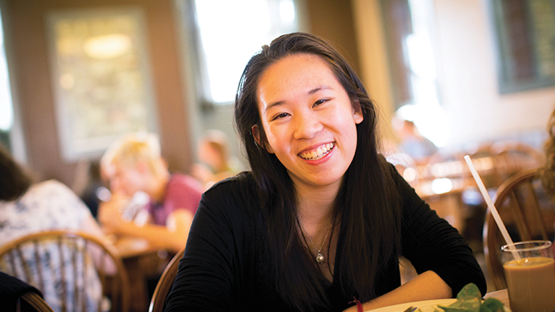 Agnes Hu in a college dining room