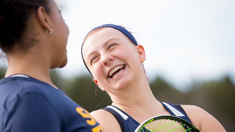 Kara VanAllen and a teammate on the tennis court