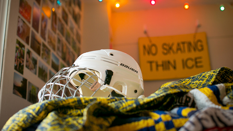 Hockey helmet and No Skating sign in Meg Johnson's room