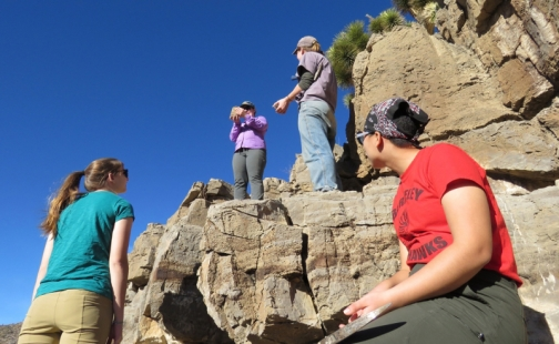 Four student geologists on a rock formation in Nevada