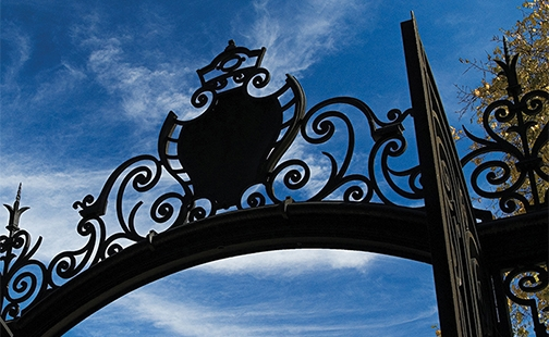 The Grecourt Gates with the blue sky visible behind them.