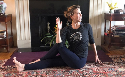 Elizabeth Brown '93 in a yoga pose
