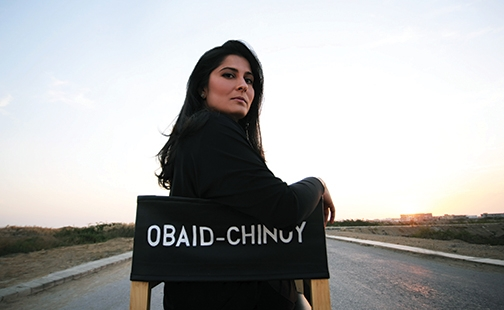 Photo of Sharmeen Obaid-Chinoy sitting in a director's chair