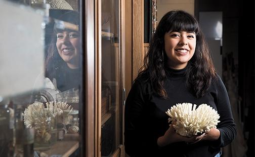 Sabrina Cordero holding a piece of coral