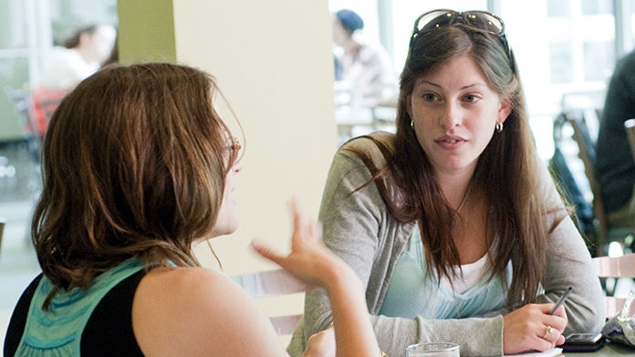 Student talking with a faculty member