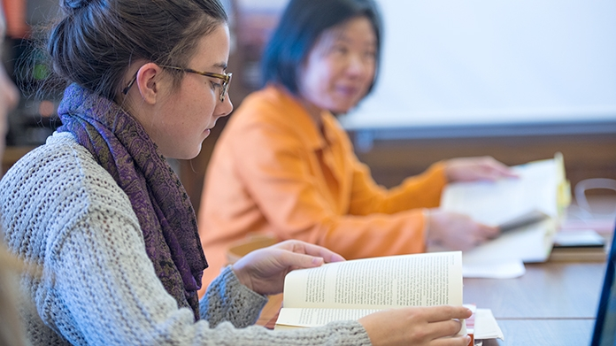 Student Reading a Book in Sujane Wu's Classroom