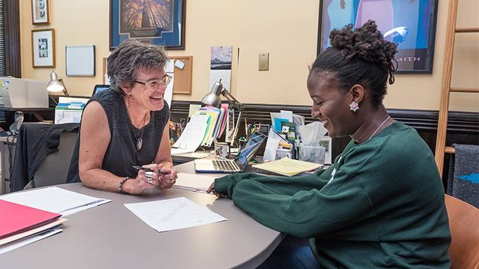 Photo of Dean Jane Stangl meeting with a student in her office