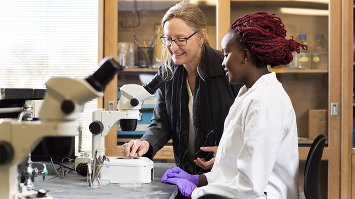 Mary Harrington with Grace Irungu '20 at microscope