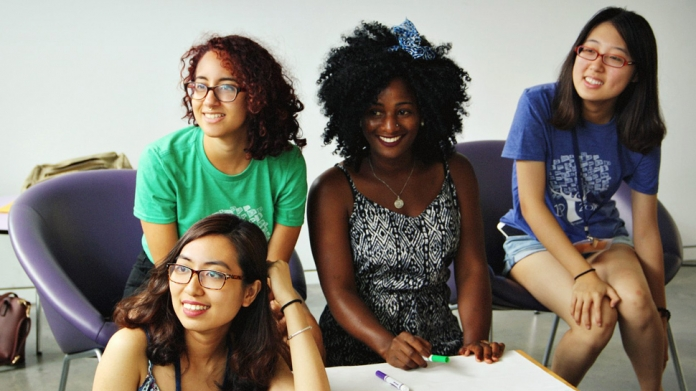 Group of international students sitting around a table, Smith College
