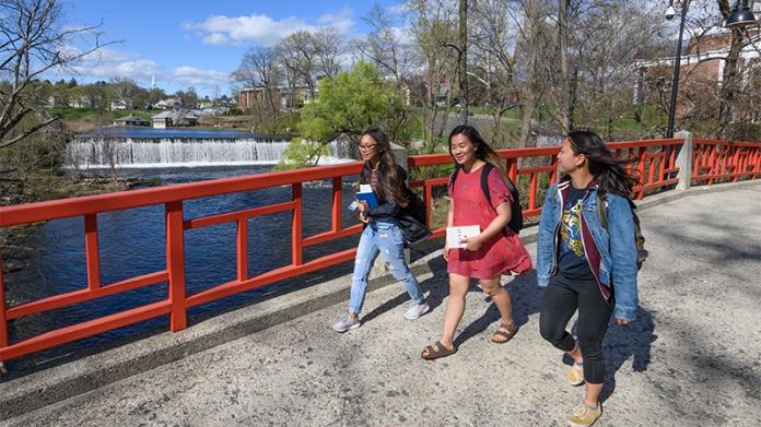 Students walking on Smith bridge