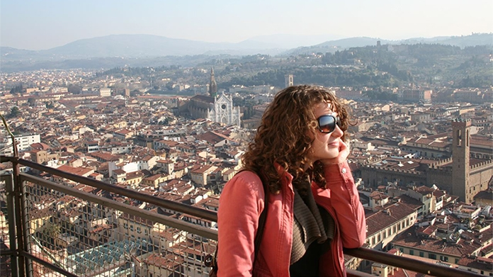Photo of a student looking out at the skyline in Florence