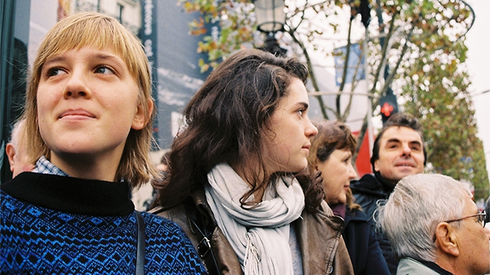 Photo of students abroad watching a protest in Paris