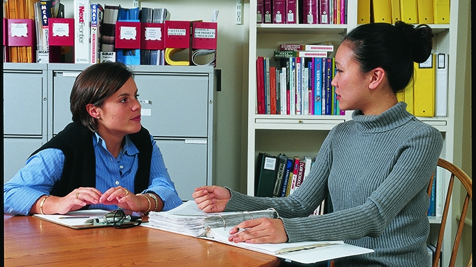 student and adviser talking