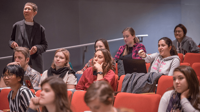 Group of students in a lecture auditorium