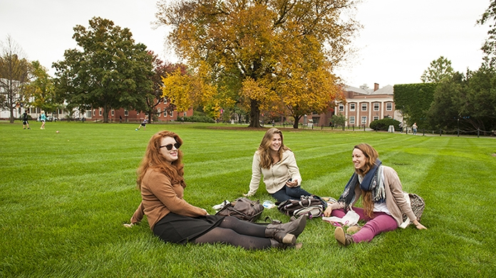 Students lounging on the lawn