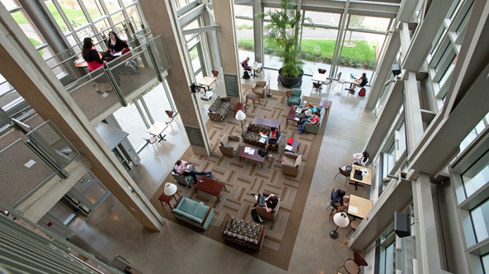 View from above the atrium in Ford Hall with students working in small groups