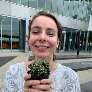 Katharine Anderson holding a succulent and smiling