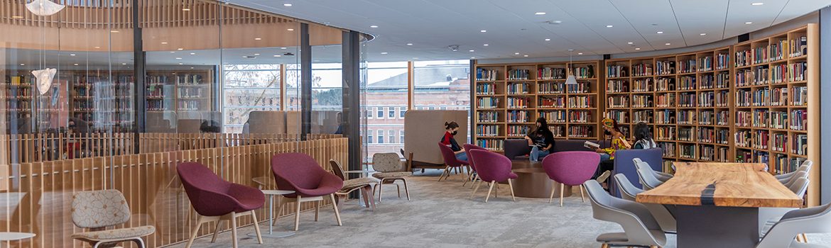 Students sitting in chairs in Neilson Library