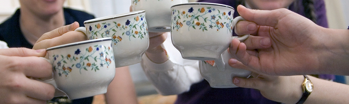 Students toasting with teacups at afternoon tea