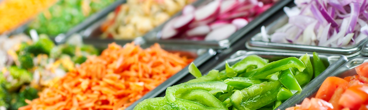 Chopped vegetable choices at a salad bar