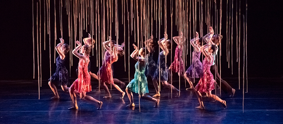 Twelve students in a dance production