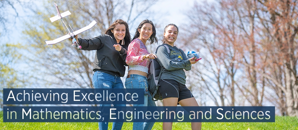 Three students posing with their engineering project. Text reads: Achieving Excellence in Mathematics, Engineering and Sciences
