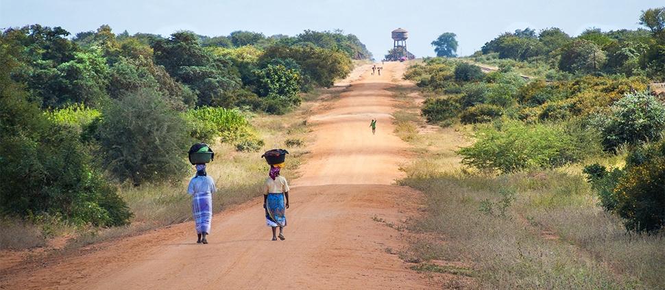 African women walking on a road