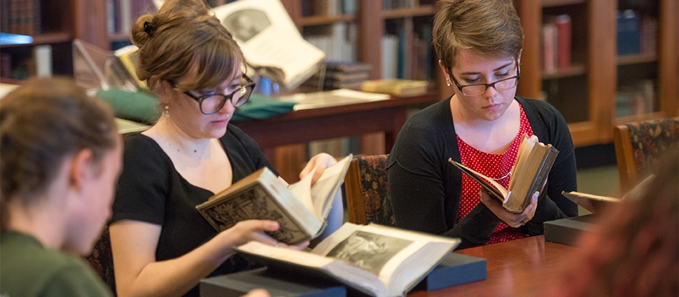 Students looking at books in the Mortimer Rare Book Room
