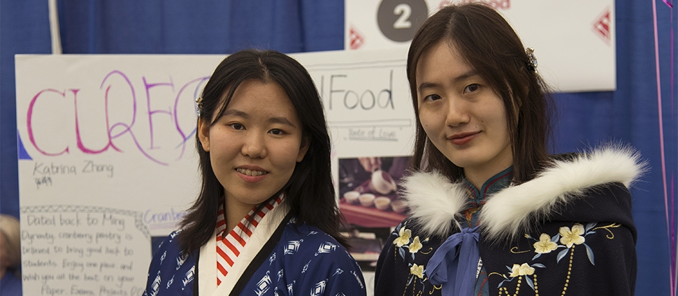 Two students at their booth at the Draper Competition